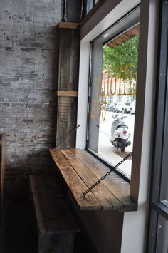 Love the look of this industrial/rustic window-front bar. I want this in my front room for people watching!