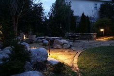 Outdoor lighting guides you safetly over the flagstone to the firepit area.
