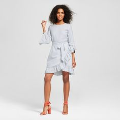 Full-on feminine, the Belted Ruffle Dress - Who What Wear™ adds amazing movement with deeply ruched trim at the arms and skirt. The dramatic tailoring draws attention to your figure and face, with an extra-long waist tie that flutters with every move; wear it with your right-now mules or get-up-and-go weekend sneakers.