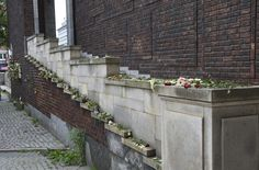 """""""Grief in the public domain"""". Flowers laid outside Oslo City Hall."""