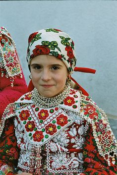 Europe | Portrait of a young girl wearing traditional clothes, Inaktelke,(Transylvania-was Hungarian land) today  Romania