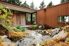 I absolutely love this outdoor area created by the interconnecting shipping containers. I simply must have this!