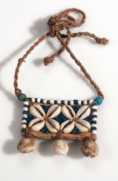 Belgian Congo Plaque / Necklace from the Kuba people of Lukengu. Plant fiber, cowrie shell, glass beads and cord, ca. Textile Jewelry, Fabric Jewelry, Tribal Jewelry, Boho Jewelry, Jewelry Crafts, Beaded Jewelry, Jewelery, Jewelry Design, Fashion Jewelry