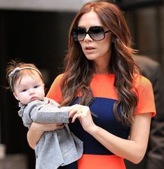 Love Victoria Beckham's color-blocked dress -- baby Harper will be inheriting some enviable hand-me-downs!