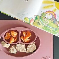 """GOOD MORNING! We are enjoying our breakfast with a book. Our favourite one! """"one light, one sun"""" ☀️ based on the song by @raffi_music. ✌🏼💕 . Enjoying an @ezpzfun breakfast too? 🍊 please share! And have a LOVELY day everyone! #onelightonesun . #onesuneveryone #ezpz #ezpzfun #ezpzcanada #breakfast #toddlerfood #toddlermeal #toddlermealideas #toddlermeals #healthybreakfast  #breakfastclub #raffi #toddlerlife #morherhoodsimplified #motherhoodthroughinstagram"""