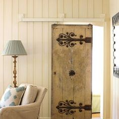 Painted barn door. If I can talk my husband into doing this for the girls' bathroom someday...