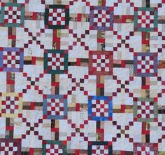 """Sixteen in the Spotlight  Top finishes at 92""""x108.5""""  You need: reds : 2 1/3 yards (for 16 patches, corners of frames, 4 patches and sashing) whites/cream: 5 1/2 yards (for 16 patches, cream strips, lights in the 4 patches, sashing, first border) bold colors such as blue, red, green: 30 - 2""""x26"""" strips browns: 2/3 yard of various scraps lighter browns/tans: 2/3 yard of various scraps 3/8 yard each of 4 colors bold colors for border pieces ½-5/8 yard of fabric for the binding. (I used scrappy…"""