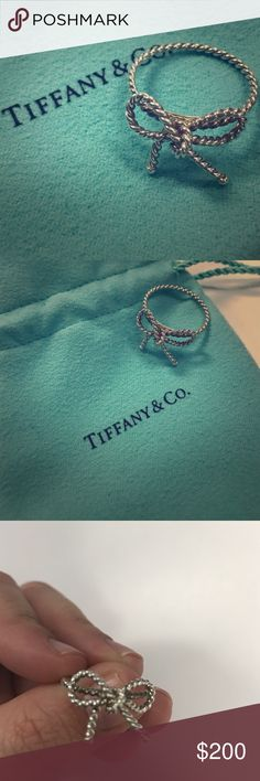 Tiffany Sterling Silver Bow Ring Tiffany Sterling Silver Bow Ring. Size 8. Barely Worn. I believe this is still sold on the website. It is sterling silver, from the bow collection, and comes with jewelry bag! Tiffany & Co. Jewelry Rings
