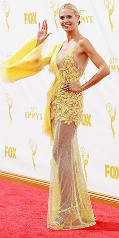 The Red Carpet's Biggest Risk Takers at the 2015 Emmys | HEIDI KLUM | Surprising no one, the supermodel wore a dress that certainly stood out, thanks to its ruffles, canary-yellow color and – oh yeah – lots and lots of skin on display.