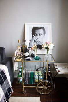 Turn Your Bar Cart into a Statement Piece! Tips for changing your bar cart from meh to wow! Bar Cart Styling, home decor, interior design, bar art, bar accessories, tortoise ice bucket, gold cocktail shaker, black and white accents