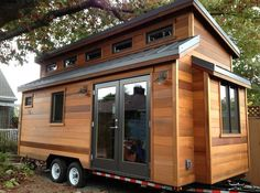 The ShelterWise design team created this house for a client who wanted a tiny house for full time living. So they came up with an energy efficient tiny home with 162 square feet of space on the mai...