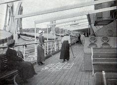 Two female passengers play shuffleboard on the Upper Promenade Deck of the S.S. United States of the Scandinavian American Line circa 1917.