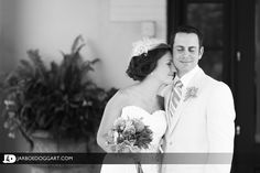 A moment of peace for a bride and groom on their wedding day.  This black and white posed wedding picture was taken at the Chanler at Cliff Walk in Newport, RI.