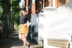 Warehouse suede button up skirt, black fedora, birkenstocks