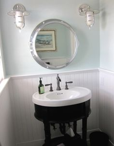 LOVE PORTHOLE MEDICINE CABINET & LIGHTS, BEADBOARD. THIS IS PERFECT FOR EITHER BATHROOM.