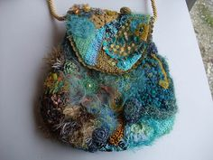 Crochet purse by @theobald on Ravelry.    I have one of her scrumbles from a swap.  So wonderful!