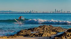 Not a very big day but there were a couple groms out ripping!  The city of Gold Coast sits across the bay from Snapper Rocks.  I thought it gave some nice depth to this photo. by _shoottheworld_