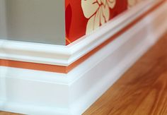 Baseboard with color strip...Great idea to add color to base boards in any room
