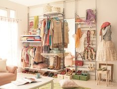 How cool would it be to have a closet like a store set up.  Cute.