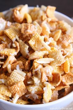 My Mom has been making this chex mix for as long as I can remember. She usually only made it a few times a year, but one of those times. Mom's Coconut Almond Chex Mix {Best Ever} Snack Mix Recipes, Appetizer Recipes, Cooking Recipes, Snack Mixes, Fudge Recipes, Candy Recipes, Easy Snacks, Yummy Snacks, Yummy Food