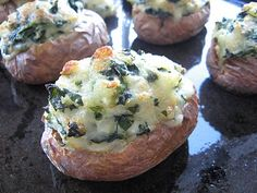 spinach and cheese stuffed potatoes.. gotta try this soon!