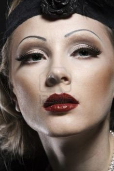 Woman's retro revival portrait. 30's of the XX century. Professional makeup Stock Photo