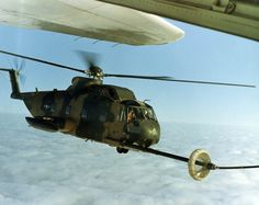 An HH-3E being refueled by an HC-130. Aerial refueling enabled the helicopters to rescue downed aircrew from any location in the Southeast Asia theater of operations. (U.S. Air Force photo)