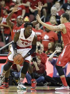 Louisville's Montrezl Harrell  is guarded in the  first