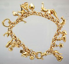 9ct Gold 23 Orted Charm Bracelet Attenborough Brokers Jewellers Bracelets