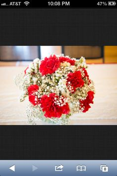 Red Carnation and baby's breath bouquet! I would prefer a different color of carnation though haha