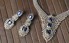 Jewellery Designs: Blue Sapphire Charming Necklace