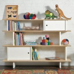 this shows asymmetrical balance since the top shelf on one side is set off by dynasoors and the other with balls and a picture frame