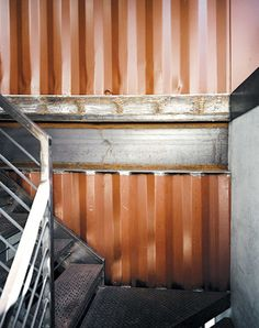 Embracing the industrial character of the corrugated steel material, he and Moseley applied the salvaged scraps as decorative siding for the hand-welded staircase.