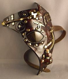 Awesome leather and metal mask by Isil Workshop. Click through to see their etsy shop.