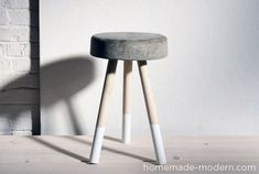 DIY stool from concrete and wooden legs. Cheap and easy, but I'm wondering about the sturdiness of it. Either way, it's also nice as an end table!