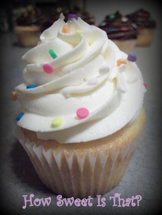 Vanilla cupcake with vanilla buttercream and pastel confetti.  Chocolate icing on the ones in the background.  The edible confetti and the piping tip used to decorate this cupcake are available on my website.