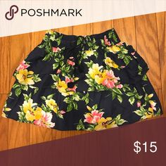 Hollister Floral Print Skirt A very pretty floral print skirt with drawstring. Soft fabric made of cotton and viscose blend. Primary color is navy blue with yellow and pink flowers. Size XS. Hollister Skirts