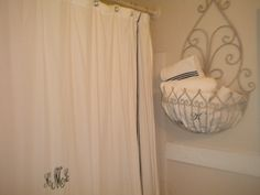 If you don't have a lot of storage space....a garden plant holder makes a perfect home for towels for a bathroom