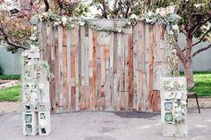 Reclaimed wood ceremony backdrop with concrete blocks ~ we ❤ this! moncheribridals.com