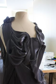 Exquisite use of fabric manipulation for fashion design - structured surface patterns; three-dimensional textile textures