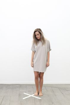 A grownup version of the borrowed-from-the-boy tee in your sleepwear drawer. The Pima Sleep Dressis an oversized, tee shirt dress with a raglan style crew neck and pockets. To be worn from Saturday night to Sunday morning brunch. For a layered look, pair with the Vivi Legging. Made in Peru.  oversized dress hits just above the knee pockets  soft and light  100% Pima cotton    LUNYA FIT TIP Oversized fit, but true to size. Size down for a snugger fit or up for length. Model...