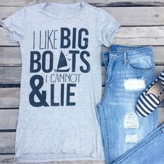 fits true to size. designer. chic. graphic. tee. 95% rayon. 5% spandex.