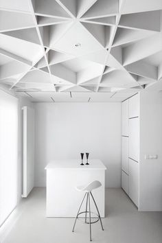 Hidden kitchen & look at that ceiling! (Wouldn't even need to be so unrelentingly white. Imagine it in birch, with accent countertop and dramatic flooring.)