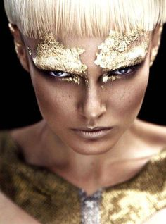Gold foil eyes Gold hair Gold jewelry (Chain, maybe thick hoop earrings)  Intense, rich look.  Very clean/fixed/airbrushed skin Maybe add a snake or other props to add to gold/egyptian feel