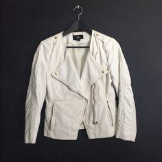 H&M moto jacket Off white moto jacket. Has cropped 3quarter length sleeves. Gold zipper and button details. Faux leather detailing on part of the sleeves. Rest of the jacket is the normal canvas material . H&M Jackets & Coats