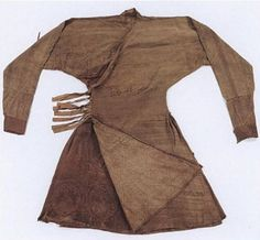 "Yuan Dynasty. Robe with 'braided"" (Bian Xian) waist. Silk and metallic thread lampas (nasij) with silk and metallic thread samite underflap. This robe—with a flaring skirt, fitted sleeves, and a wide waistband with simulated braiding—represents the signature garment of Mongol men. This example is an early piece; later examples feature fine pleats beneath the entire waistband. 142 X 246 cm. Excavated at Mingshuicun, Damao Banner, Baotou, Inner Mongolia. Inner Mongolia Autonomous Region…"