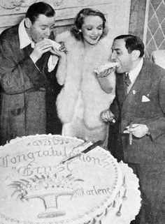 Marlene with Ernest Lubitsch (right), a fellow German refugee who became the head of Paramount's West Coast studio for a time. Lubitsch tried to help her secure better roles. Notice the large cake celebrating his promotion, a gift from Marlene.