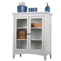 Place this simple cabinet in a bathroom or closet to keep things tidy as well as in plain sight.