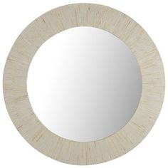 Select mother-of-pearl shells are inlaid to form the ivory frames that define these gorgeous wall mirrors. Their silvery silhouettes reflect just why seafaring cultures have always collected such treasures for good luck. Take one home and you're sure to feel fortunate, too.
