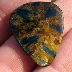 This stone guitar pick is made from Pietersite from Namibia.  I sell these and other stone guitar picks www.digforcrystals.com